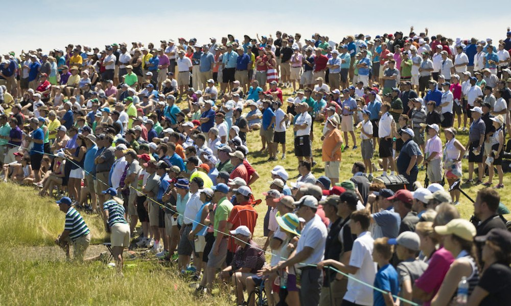 Jun 15, 2014; Pinehurst, NC, USA; Spectators in the grandstands watch Gary Woodland (not pictured) tee shot on the sixth hole during the final round of the 2014 U.S. Open golf tournament at Pinehurst Resort Country Club - #2 Course. Mandatory Credit: Jason Getz-USA TODAY Sports