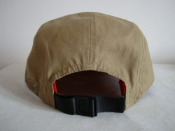 Custom 5 Panel Cap with leather embossed badge to the front`