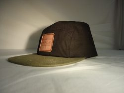 ae46679a ... Custom 5 Panel Cap with leather embossed badge to the front ...
