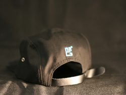 Custom 5 Panel Cap with leather embossed badge to the front