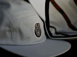 Custom 5 Panel Cap with woven badge and printed taping.